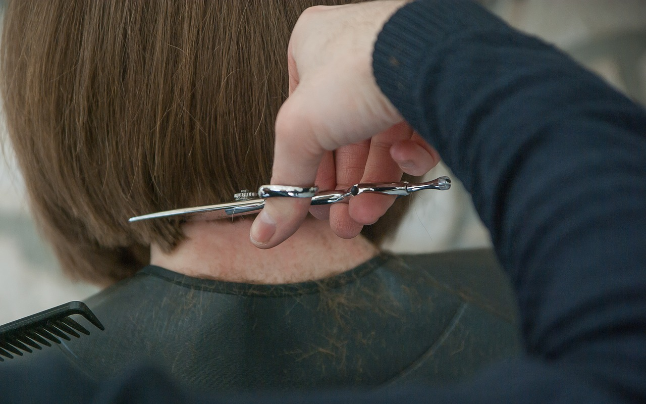 Photo of a hairdresser cutting a bob style cut