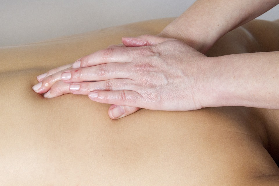 Photo of a lady receiving a back massage